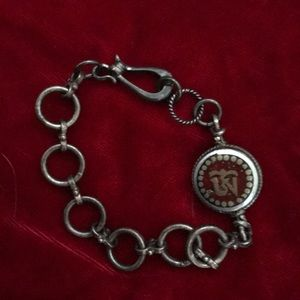 Coral and brass ohm bracelet with sterling links